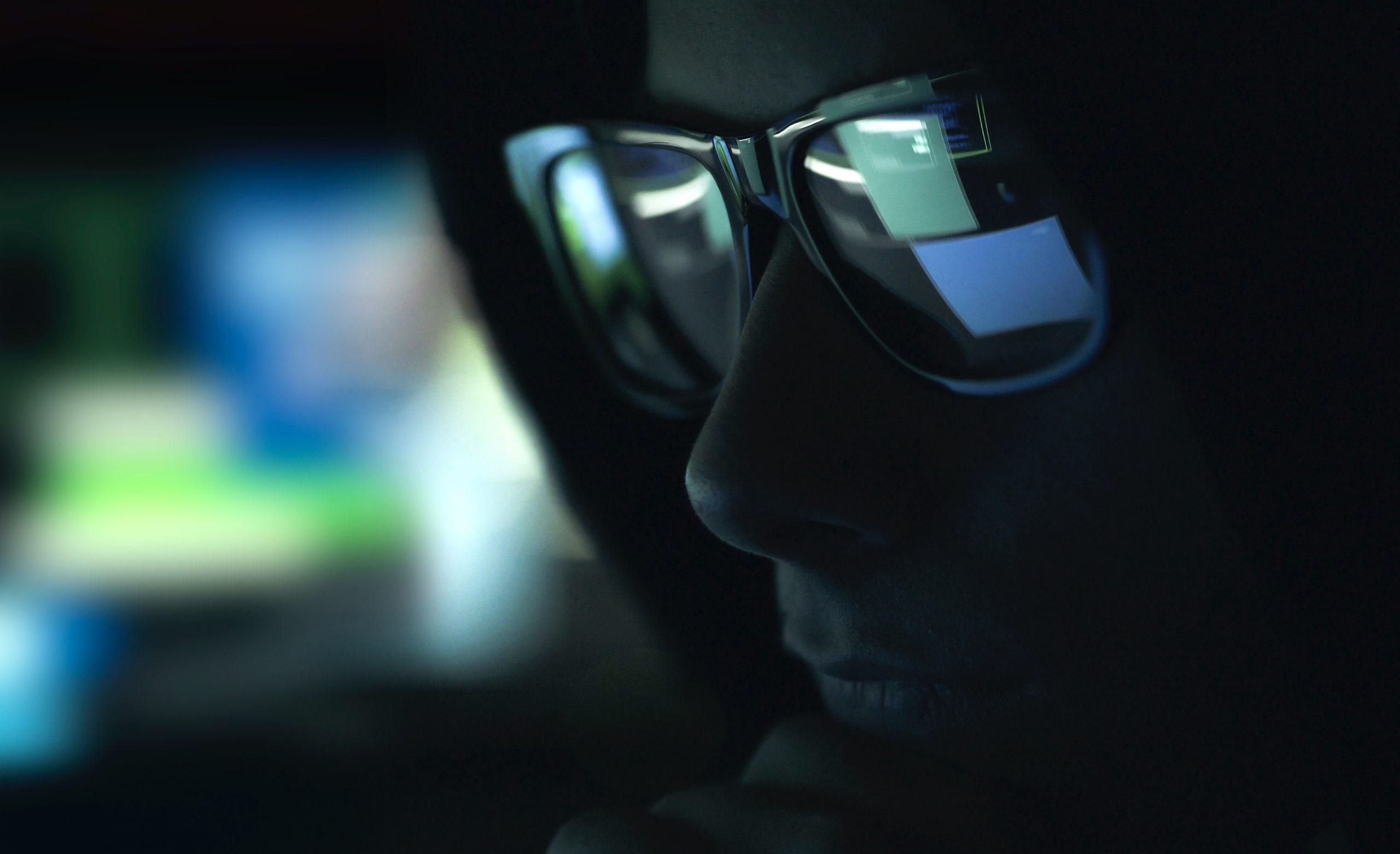 nerd-hacker-with-glasses-in-the-dark-Z632G4Q